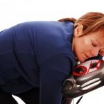 Woman sleeping on exercise bike