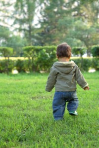 Child walking in grass