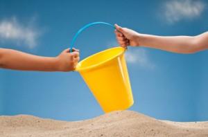 Sand bucket - children sharing